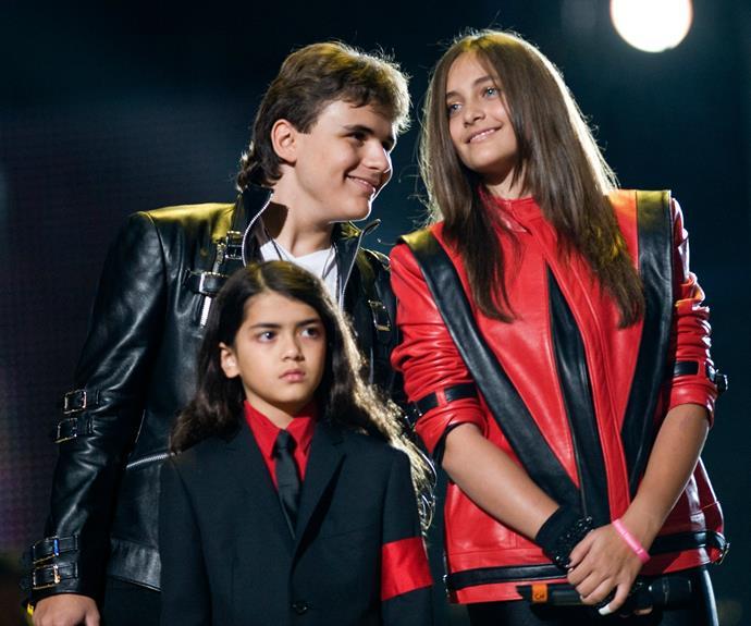Blanket is pictured in 2011 alongside his older siblings, Prince and Paris.