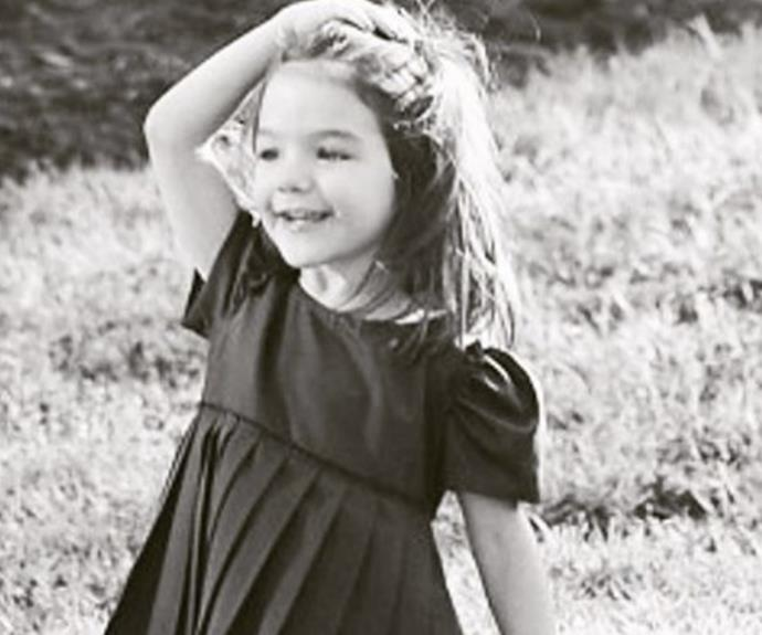 "Katie Holmes took to Instagram to share an adorable (and very rare) photo of her ""sweet angel"" daughter, Suri Cruise. In the throwback snap, Suri – now 10 – looks exactly like her mummy and we just can't get enough of that darling smile."