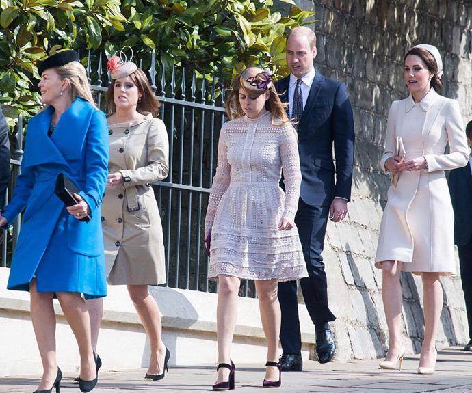 The young royals make their way to the service from Windsor Castle on foot.
