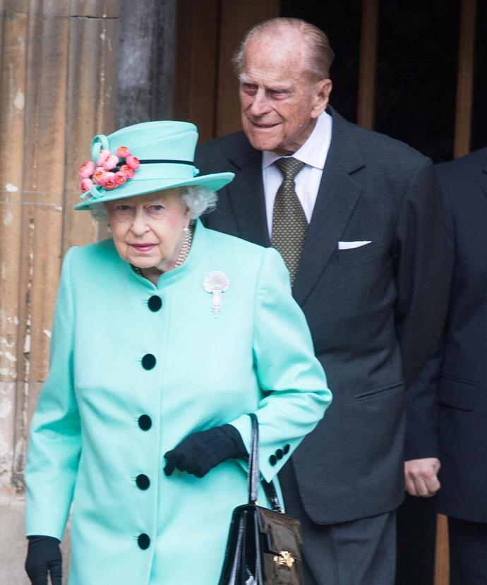 Prince Philip, 95, followed in a dapper suit.