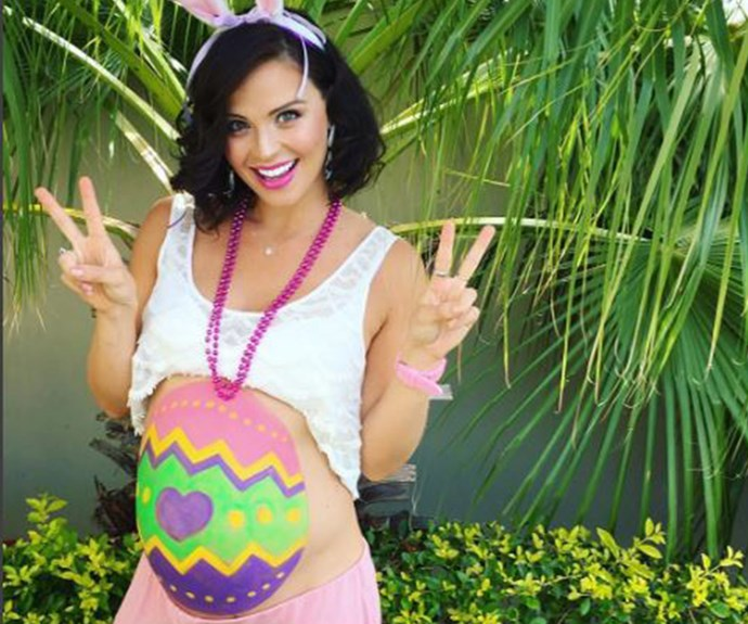 """""""I couldn't resist! I have the biggest EASTER EGG right on my body, with the cutest little chicken inside! Just needed my mama to decorate it for me,"""" Lauren Brant revealed her bump alongside this snap of her painted belly."""