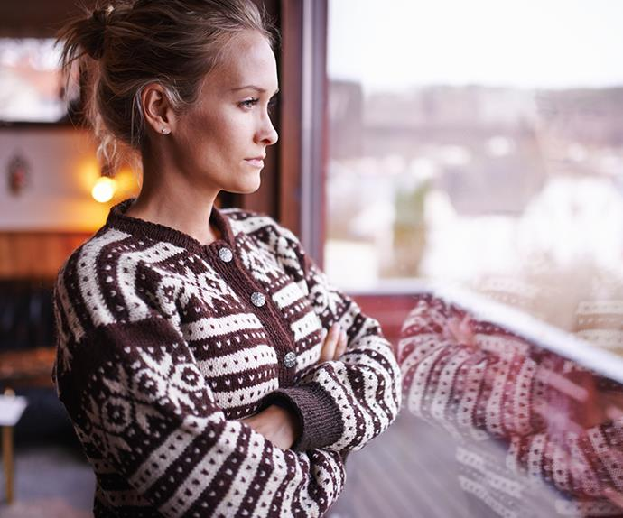Woman staring out of window