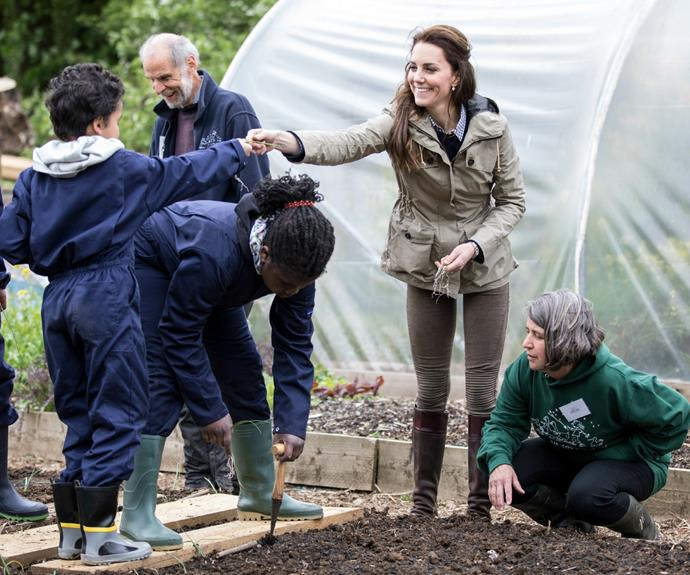 While planting onions, Kate asked the children if they had ever held a worm.