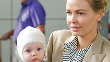 World, meet Racer! Lara Bingle touches down in Sydney with her son
