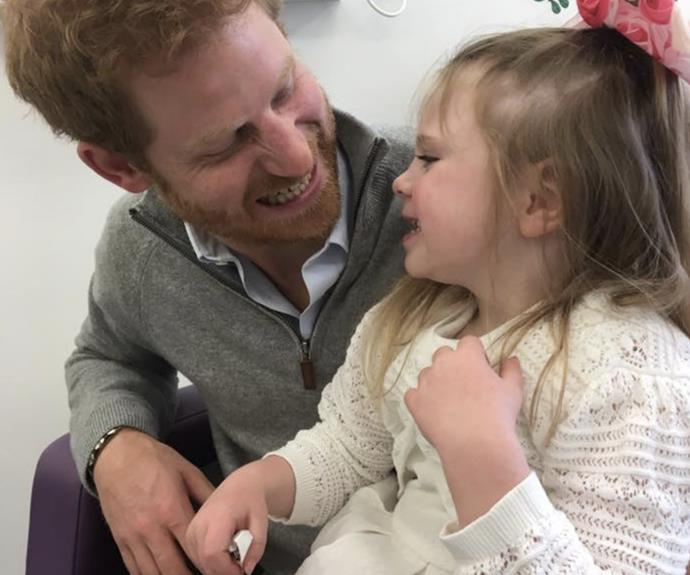 The royal and little Amelia share a moment of happiness. (Image via Facebook/Ollie's Army Battling Against Battens)