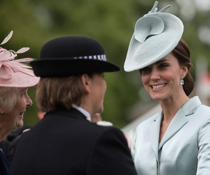 She finished off her look with an elegant blue hat.