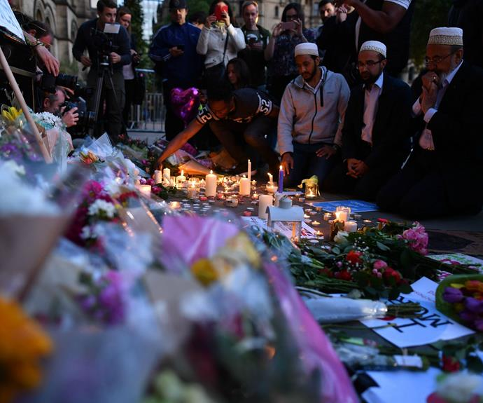People light candles in solidarity with those killed and injured in the terror attack at the Ariana Grande concert at the Manchester Arena.