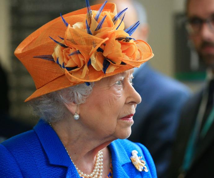 The Queen chose to wear a vivid blue coat and coordinating tangerine hat for the important visit.