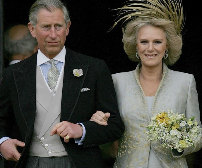 Charles and Camilla are pictured following the church blessing of their civil wedding ceremony, 09 April 2005.