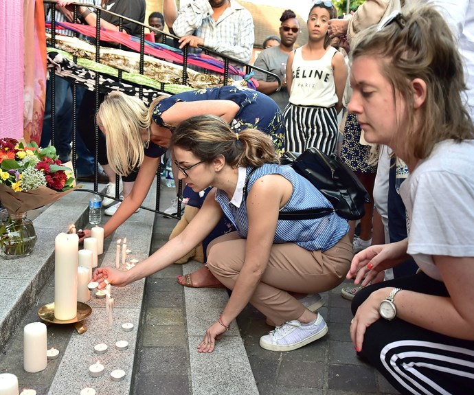 Candles have been lit near the 24-storey residential tower in memory of those who've lost their lives.