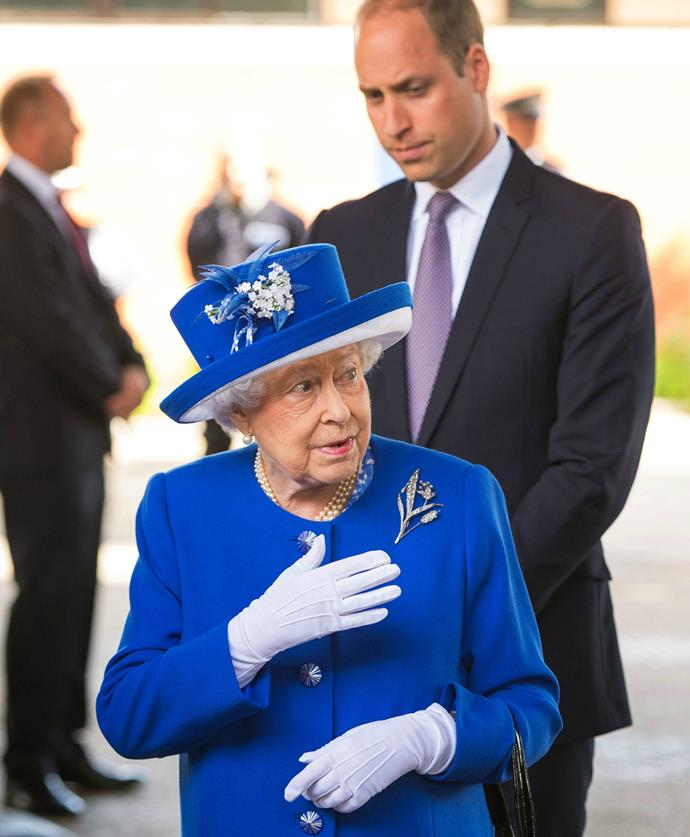 The Queen and her grandson were heckled by a distraught man as they left the makeshift centre.