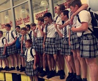 Schoolboys stage mass skirt-wearing protest as school upholds 'shorts ban' during heatwave
