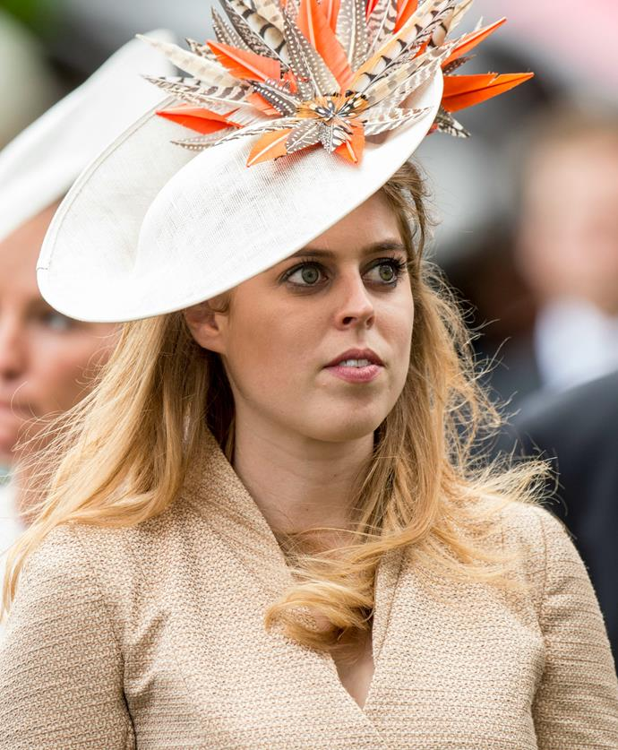 Beatrice looked striking in a rose gold coat and coordinating hat.