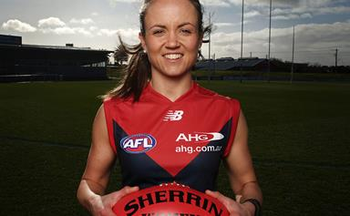 Not all heroes wear capes… Meet the multitasking midwife who's changing the face of the AFL