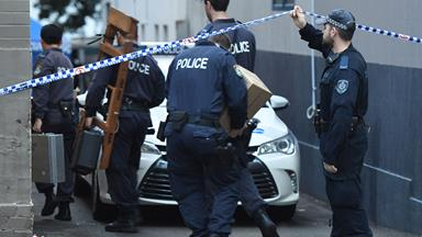 Anti-terrorism raids continue in Sydney after police foil an alleged plan to detonate bomb on plane