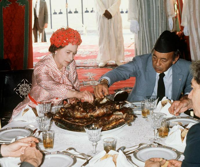 The Queen chows down while touring Morocco.