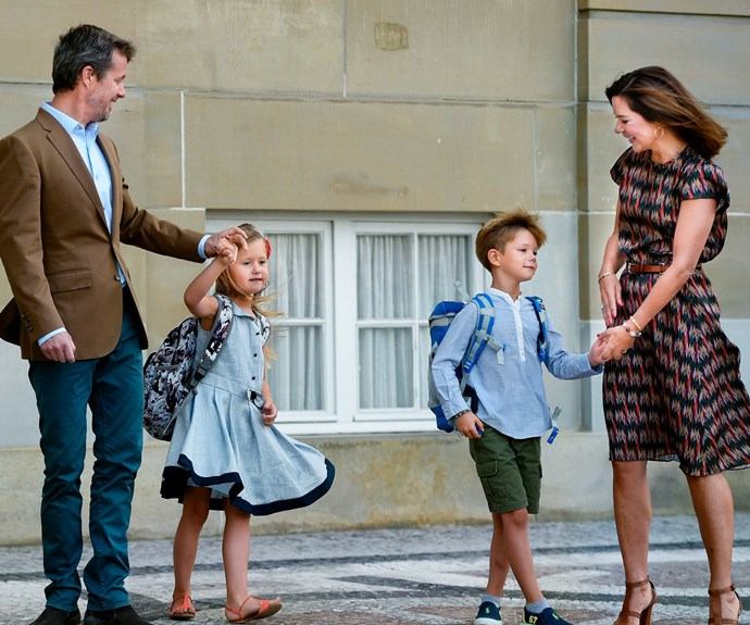 The children were seen twirling around and joking on the palace forecourt.