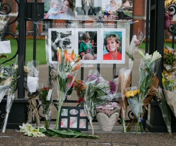Tributes remembering Princess Diana have begun to flood 'The Golden Gates' of Kensington Palace.