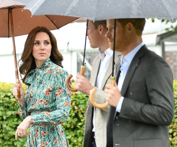 Duchess Catherine with Prince William and Prince Harry visiting the memorial to the late Princess Diana last week.
