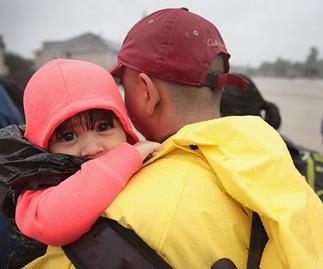 Three-year-old found floating on her drowned mother amidst Hurricane Harvey destruction