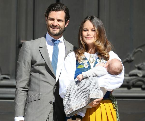 Prince Carl Philip and Princess Sofia are pictured with their first born, Prince Alexander, shortly after his birth.