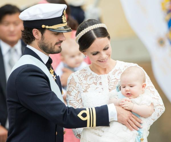 Prince Carl Philip and Princess Sofia are pictured at the christening of their first born, Prince Alexander.