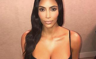 Kim Kardashian poses naked in a tree - and of course everyone has an opinion!