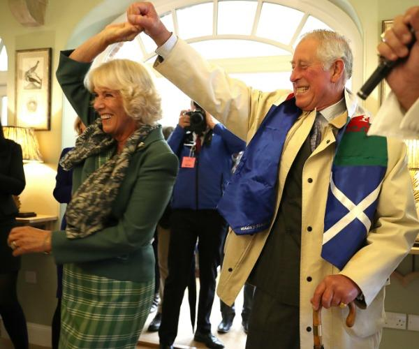 The Duke and Duchess of Cornwall have been snapped twirling, laughing and embracing at a tea dance in the Walled Garden Pavilion at Dumfries House, Scotland. The royals, who were were serenaded by an Elvis impersonator during the amorous display, are currently in the country to mark a decade since the stately home was saved for the nation by the Prince.