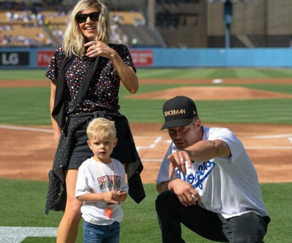 The former couple are pictured with their four-year-old son, Axl Jack.
