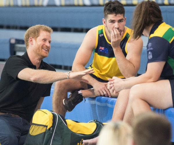 Harry was seen chatting happily with members of the Australian swimming team.