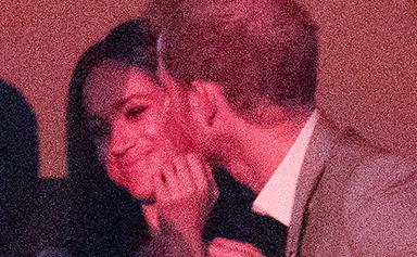 Sealed with a kiss! Prince Harry and Meghan Markle pack on the PDA at the Invictus Games