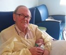 Meet the 'ICU Grandpa' who cuddles sick and premature babies when their parents can't be there