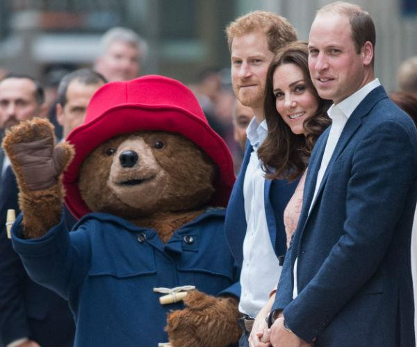 The golden royal trio paid a visit to the cast and crew from the upcoming film Paddington 2.