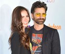 Have mercy! John Stamos and Caitlin McHugh are engaged and our 90s hearts are breaking