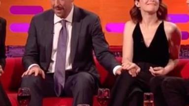 Claire Foy subtly puts Adam Sandler in his place after he repeatedly touches her on TV