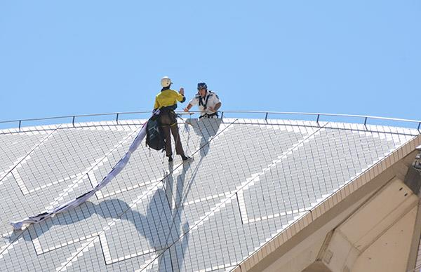 Activists scale the iconic Sydney Opera House in protest of the Manus Island humanitarian crisis