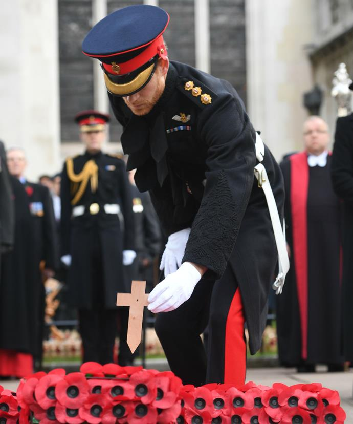 Prince Harry laid a cross during the ceremony in memory of those who made the ultimate sacrifice.