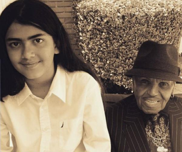 """Michael Jackson's father, Joe, recently took to social media to share a rare photo of his grandson -- Blanket """"Bigi"""" Jackson. The 89-year-old Jackson family patriarch is also featured in the sepia-filtered snap."""