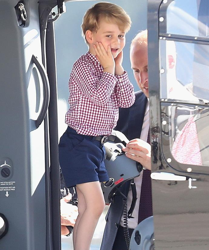 The little royal was pictured captivated by a helicopter during the family's tour of Poland and Germany.