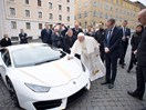 Wait, the Pope is giving away a white and gold Lamborghini because ..why?