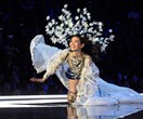 Going, going, gone! Model Ming Xi stacks it on the Victoria's Secret runway