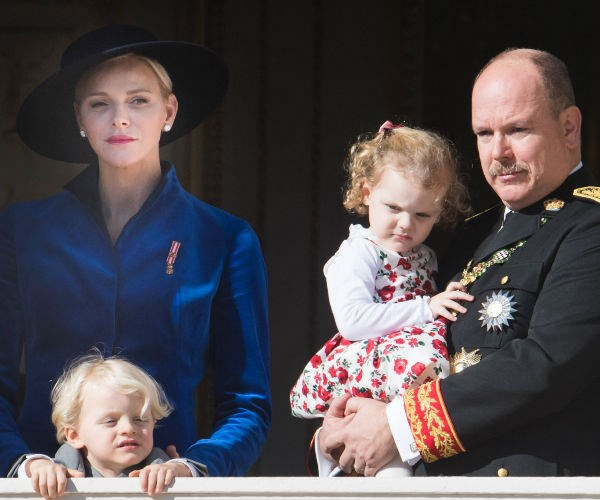 Princess Charlene wore a sumptuous deep blue coat and wide-brimmed hat for the important family occasion.