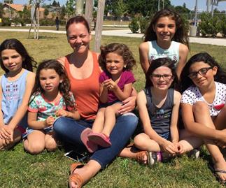 Californian woman adopts six girls