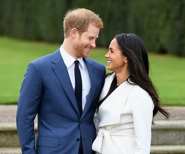 Prince Harry and Meghan Markle face the press after announcing their engagement.