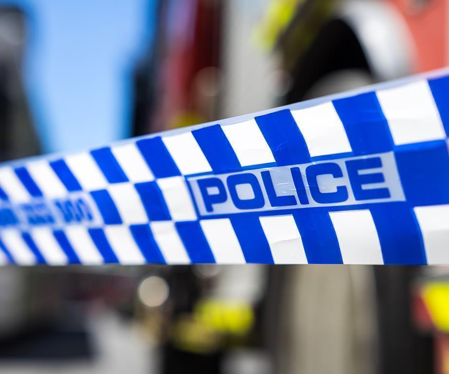 Sydney woman, 78, mauled by three pet dogs at home