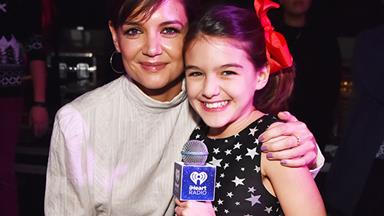 Suri Cruise finally embraces the spotlight by introducing Taylor Swift at iHeartRadio's Jingle Ball