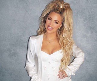 Khloe Kardashian makes her first official appearance since confirming her pregnancy and she's glowing!
