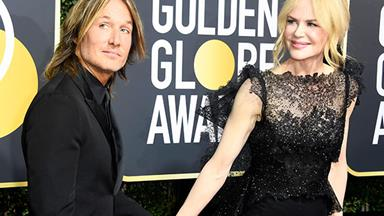 Nicole Kidman and Keith Urban just had the most awkward kiss at the Golden Globes & we can't look away