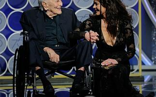 Our hearts! 101-year-old Kirk Douglas presents an award with daughter-in-law Catherine Zeta Jones at the Globes