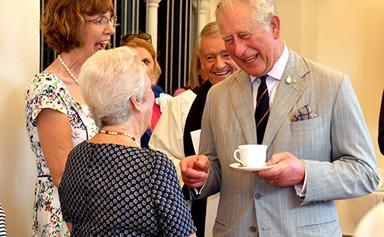 Prince Charles heads to Cairns for a packed day with tears, tea and bugles
